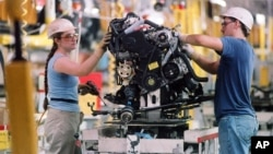 Workers at a Toyota factory in Georgetown, Kentucky.