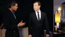 Russian Prime Minister Dmitry Medvedev (R) takes part in an interview with CNN news channel in Davos January 23, 2013.