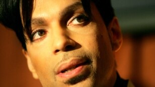 """FILE - Recording artist Prince speaks during a news conference about his recording agreement between himself and Universal Records and his new single """"Te Amo Corazon,"""" Beverly Hills, California, Dec. 13, 2005."""