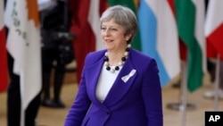 La primera ministra británica, Theresa May, es vista a su arribo al edificio de la Unión Europea, en Bruselas, el jueves, 22 de marzo, de 2018.