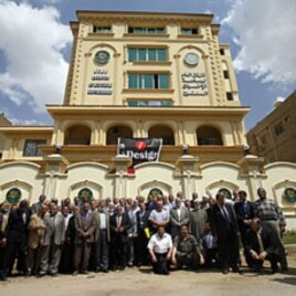 Egyptian Muslim Brotherhood members outside the party's new headquarters in Cairo, April 30, 2011