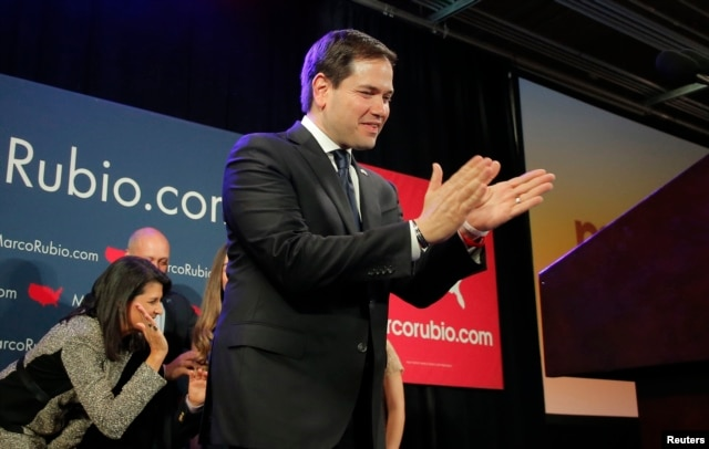 U.S. Republican presidential candidate Marco Rubio applauds as he approaches the podium to speak to supporters at a South Carolina primary night rally in Columbia, S.C., Feb. 20, 2016.