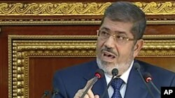 Image from Egyptian State Television shows Egyptian President Mohammed Morsi speaking at the Shura Council, the country's upper house of parliament, Cairo, December 29, 2012.