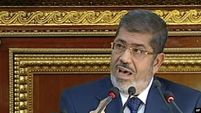 FILE - Egyptian President Mohammed Morsi, December 29, 2012.