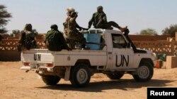 FILE - Chadian U.N. peacekeepers gesture as they patrol in Aguelhok, Mali.