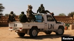 FILE - Chadian U.N. peacekeepers patrol in Aguelhok, Mali, Jan. 24, 2014.