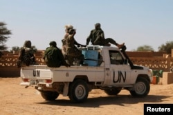 FILE - U.N. peacekeepers patrol in Aguelhok, Mali, Jan. 24, 2014.