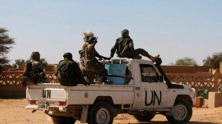 Chadian U.N. peacekeepers gesture as they patrol in Aguelhok, Mali, Jan. 24, 2014.