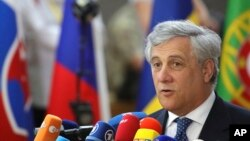 FILE - European Parliament President Antonio Tajani speaks with the media as he arrives for an EU summit at the Europa building in Brussels, June 22, 2017.