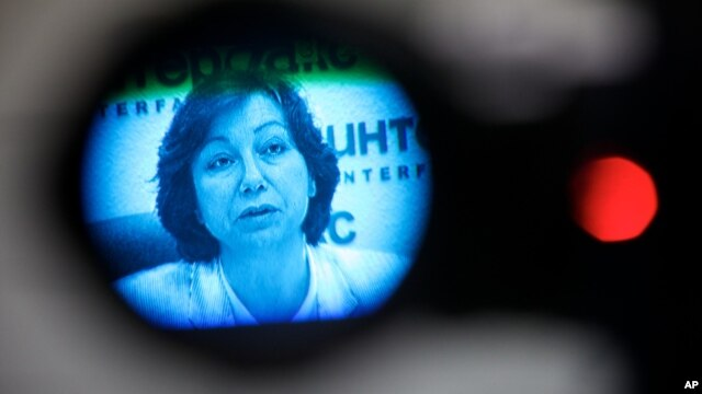 Syrian National Council representative, spokeswoman Basma Kodmani seen through a TV camera viewfinder answers a question during a news conference in Moscow, Russia, Tuesday, July 10, 2012.