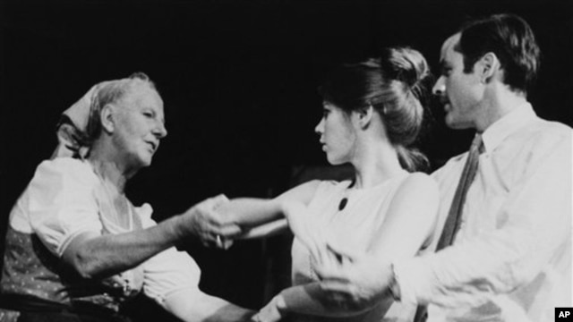 """FILE - Baroness Maria Von Trapp rehearses Mary Small and Barney Hodges in a scene from the play """"The Sound of Music,"""" which was based on her own life in Austria, Stowe, Vermont, Aug. 9, 1966."""