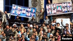 Relatives of 27 Egyptian Coptic Christian workers who were kidnapped in the Libyan city of Sirte, take part in a protest to call for their release, in Cairo, February 13, 2015.