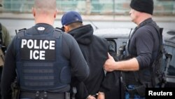 U.S. Immigration and Customs Enforcement officers detain a suspect as they conduct a targeted enforcement operation in Los Angeles, Feb. 7, 2017.