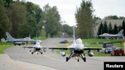 ဘယ္လ္ဂ်ီယံ F-16 တိုက္ေလယာဥ္ေတြ IS စစ္ေသြးႂကြေတြ တိုက္ခုိက္ဖို႔ ႏိုင္ငံတကာ မဟာမိတ္အဖဲြ႔ဆီ ပ်ံသန္းစဥ္။ (၀၉-၂၆-၁၄)