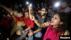 People chant slogans as they attend a sit-in protest at Shahbagh intersection demanding capital punishment for Bangladesh's Jamaat-e-Islami senior leader Abdul Quader Mollah after he won a dramatic stay of execution before he was due to be hanged in Dhaka
