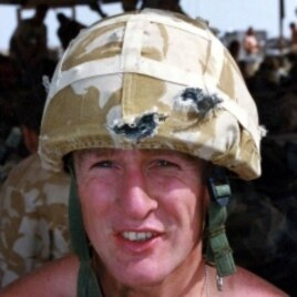 British Royal Marine Eric Walderman wears the Kevlar helmet that saved him from four bullets during fighting in southern Iraq in March 2003