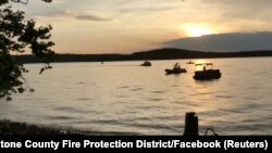 Rescue personnel work after an amphibious duck boat capsized and sank at Table Rock Lake near Branson, Missouri, July 19, 2018, in this still image obtained from a video on social media.