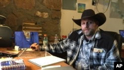 Ammon Bundy sits at a desk he's using at the Malheur National Wildlife Refuge in Oregon, Jan. 22, 2016.
