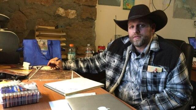 Ammon Bundy sits at a desk he's using at the Malheur National Wildlife Refuge in Oregon, Jan. 22, 2016.