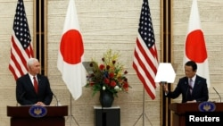 U.S. Vice President Mike Pence (L) and Japan's Deputy Prime Minister Taro Aso attend their joint news conference after their talks at the Prime Minister Shinzo Abe's official residence in Tokyo, April 18, 2017.