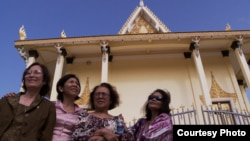 The three survivors of the Khmer Rouge regime, along with a Cambodian American professor Leakhena Nov, at a temple in Phnom Penh. (Courtesy Photo​ of Michael Siv)