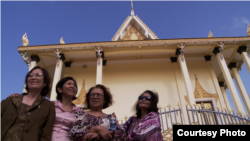 The three survivors, along with a Cambodian American professor Leakhena Nov, at the temple. (Courtesy Photo​ of Michael Siv)