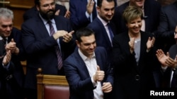 Greek Prime Minister Alexis Tsipras gives a thumbs-up after winning a confidence vote in Athens, Greece, Jan. 16, 2019.