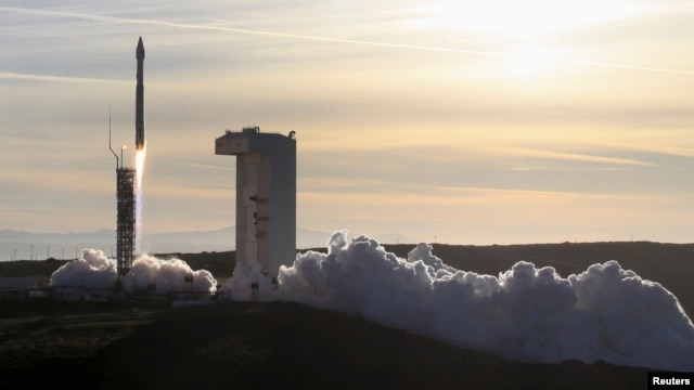 FILE - An Atlas 5 rocket carrying a satellite is launched from Vandenberg Air Force Base in California.