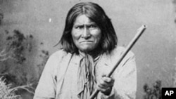 The famed Indian warrior Geronimo, a Chiricahua Apache, posing with a rifle in 1887
