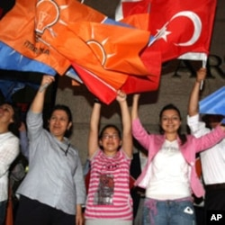 Supporters celebrate Erdogan's Justice and Development Party winning a third term in elections this year, Ankara, June 12, 2011.