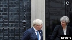 FILE - Britain's Prime Minister Theresa May (R) is seen alongside Foreign Secretary Boris Johnson, at 10 Downing street in London, May 11, 2017.
