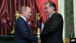 FILE - Russian President Vladimir Putin shakes hands with his Tajikistan's counterpart Emomali Rakhmon (R) at the Kremlin, Moscow.