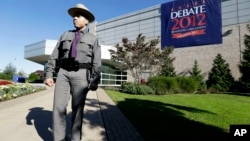 FILE – A New York state trooper stands outside the site of a debate between President Barack Obama and the Republican presidential nominee, former Massachusetts Gov. Mitt Romney, at Hofstra University's David S. Mack Sports Complex in Hempstead, New York.