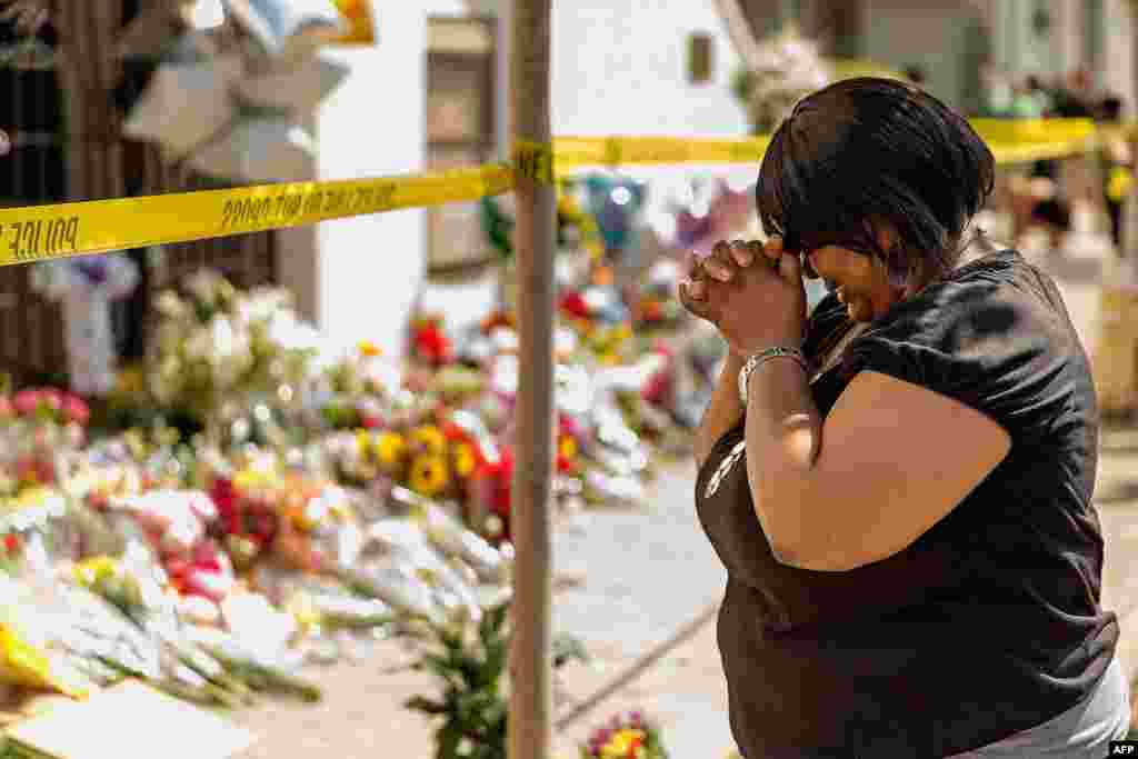 A woman weeps outside the historic Emanuel African Methodist Episcopal Church, Charleston, South Carolina. A mass shooting took the lives of nine people in the church on Wednesday.