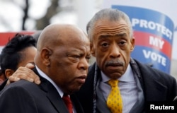 U.S. Rep. John Lewis (L) and the Rev. Al Sharpton confer during a voter's rights rally in front of the U.S. Supreme Court in Washington, Feb. 27, 2013.