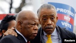 Congressman John Lewis and Rev. Al Sharpton at a voter rights rally at the US Supreme Court in Washington, Feb. 27, 2013.
