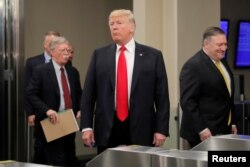 U.S. President Donald Trump arrives at United Nations headquarters with Secretary of State Mike Pompeo (R) and National Security Advisor John Bolton (L) during the 73rd United Nations General Assembly in New York, Sept. 24, 2018.