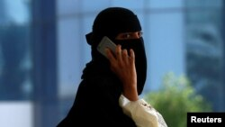 FILE - A Saudi woman speaks on the phone in Riyadh, Saudi Arabia, Oct. 2, 2017.