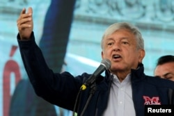 Mexico's President-elect Andres Manuel Lopez Obrador talks to supporters in Monterrey, Oct. 19, 2018.