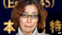 Junko Ishido, mother of Japanese journalist Keni Goto taken hostage by Islamic State, speaks during a press conference in Tokyo, Friday, Jan. 23, 2015.