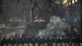 Riot police officers take position outside Kyiv's Independence Square, the epicenter of the country's current unrest, Ukraine, Feb. 1, 2014.