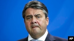 FILE - In this June 29, 2015 file picture Vice Chancellor and Economy Minister Sigmar Gabriel briefs the media, at the chancellery in Berlin.