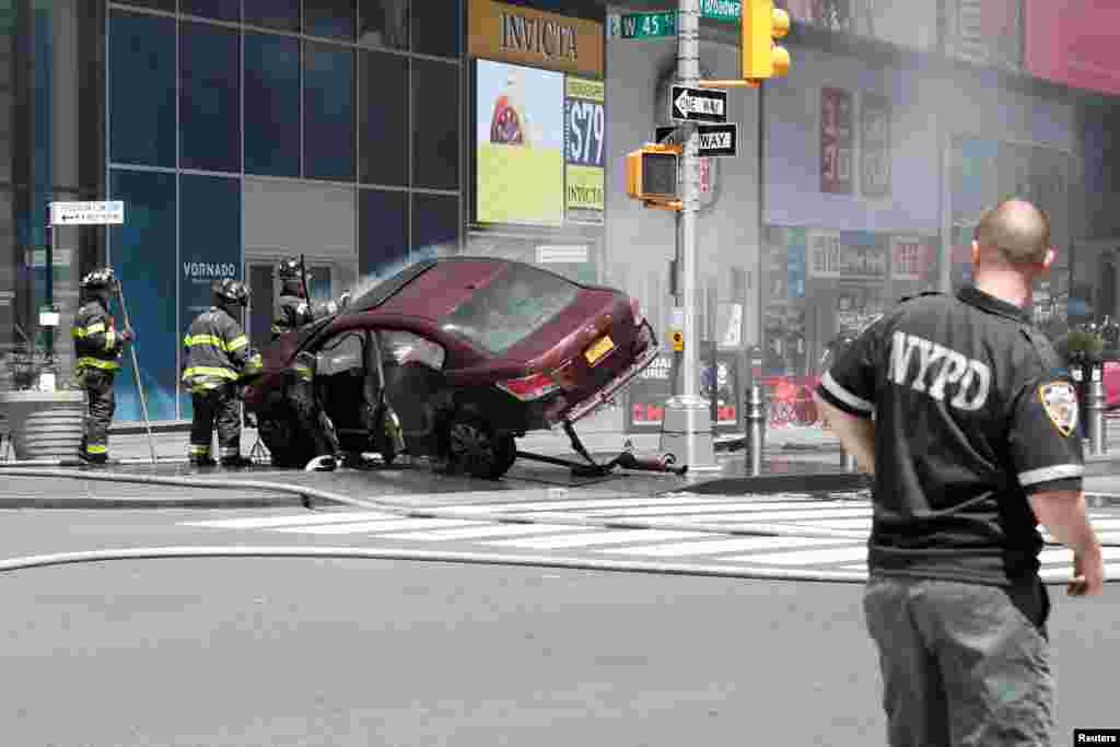 A vehicle that struck pedestrians in Times Square crashes on the sidewalk in New York City, killing one person and injuring more than 20 pedestrians.