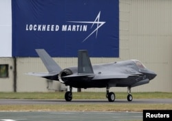 FILE - A RAF Lockheed Martin F-35B fighter jet taxis along a runway after landing at the Royal International Air Tattoo at Fairford, Britain, July 8, 2016.