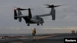 FILE - A U.S. Marines MV-22 Osprey Aircraft lands on the deck of the USS Bonhomme Richard amphibious assault ship off the coast of Sydney, Australia, June 29, 2017.