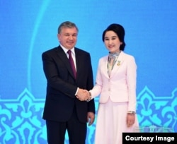 President Mirziyoyev with Zulfiya award recipient, Tashkent, March 7, 2018. Zulfiya is a state award given to girls for success and contribution in science, arts and sports.