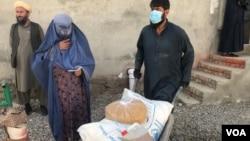 BMT yordam dasturi orqali afg'onlarga oziq-ovqat berilmoqda.