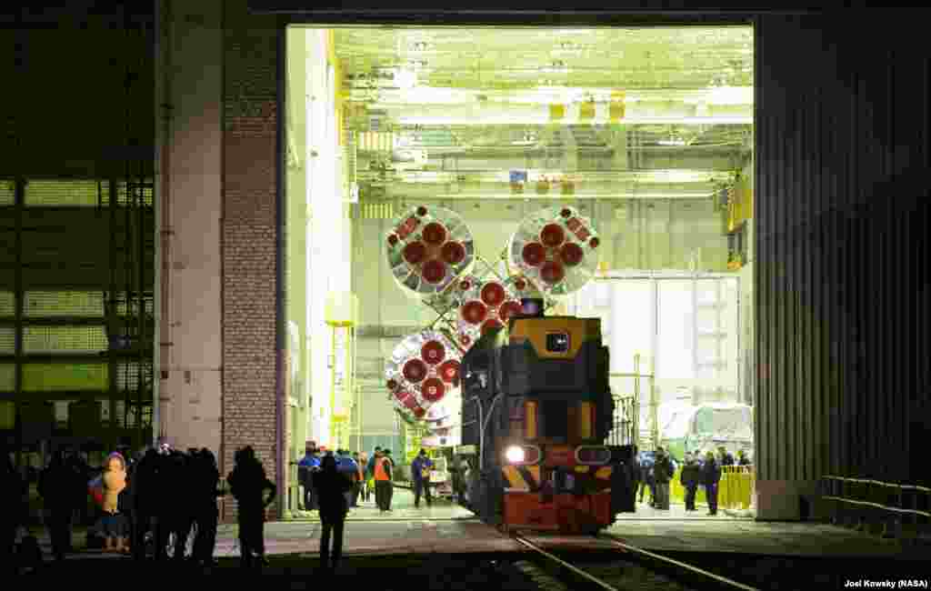 The Soyuz TMA-19M spacecraft is rolled out by train to the launch pad at the Baikonur Cosmodrome in Kazakhstan.