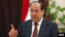 Perdana Menteri Irak Nouri al-Maliki bertemu dengan para pejabat di Mesir