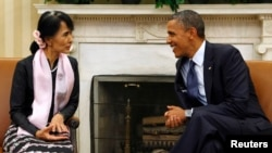 U.S. President Barack Obama speaks with Myanmar opposition leader Aung San Suu Kyi